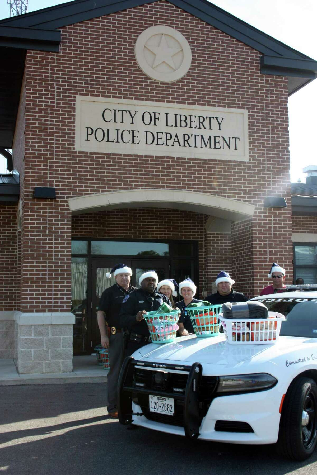 Liberty police officers prepared 18 gift baskets to be delivered to senior citizens for the Silver Santa project.