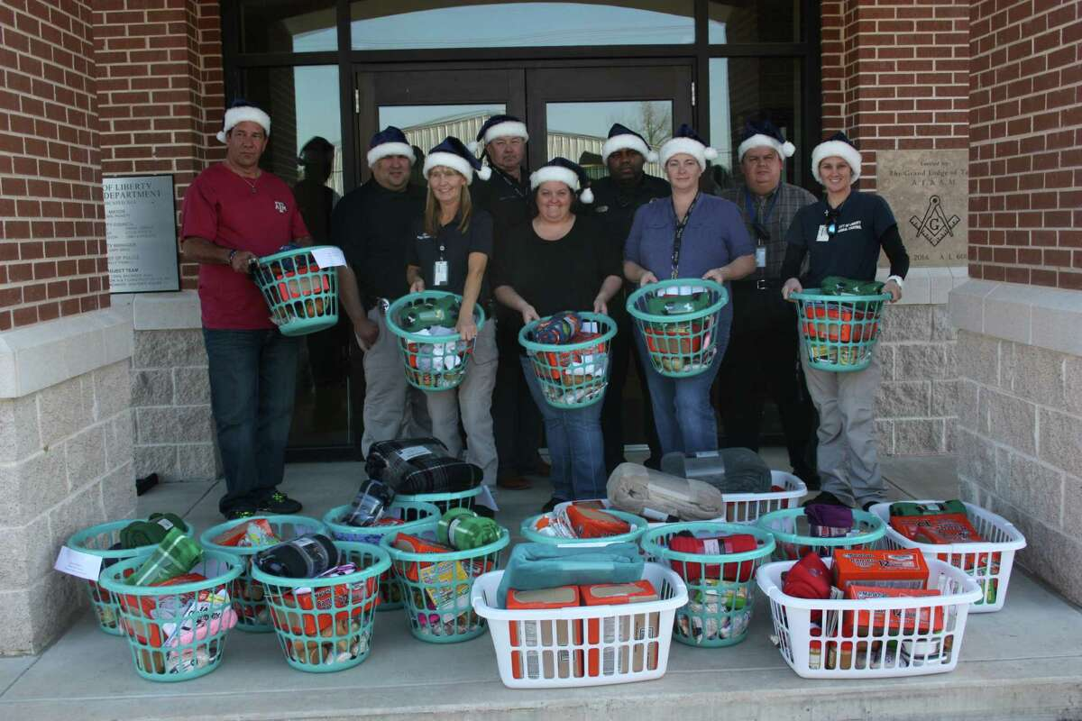 Liberty Police Department personnel line up the 18 gift baskets that were delivered to senior citizens in the area on Dec. 21.