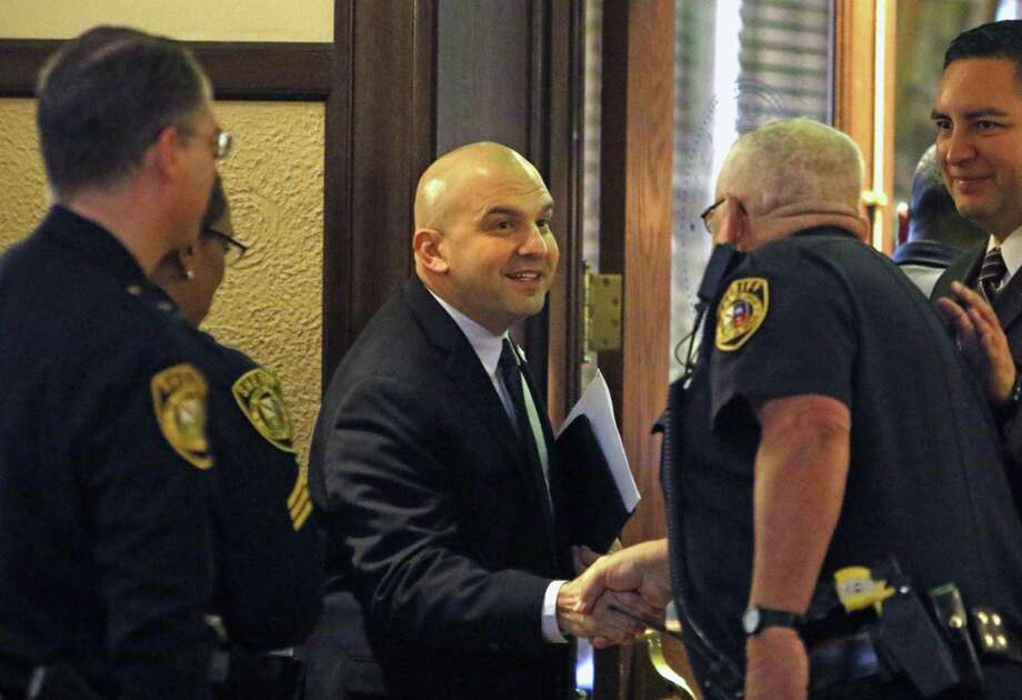 New Sheriff Javier Salazar congratulates deputies after new contract was approved. Sheriff Susan Pamerleau in her final appearance at Commissioners Court, where she will ask for funds for 15,000 hours of jailer overtime in January-March, when the new sheriff (Javier Salazar) will be taking over. Photos taken at Double-height Courtroom, Bexar County Courthouse on Thursday, December 23, 2016 . Photo: Ron Cortes, Freelance / For The San Antonio Express-News / Ronald Cortes / Freelance