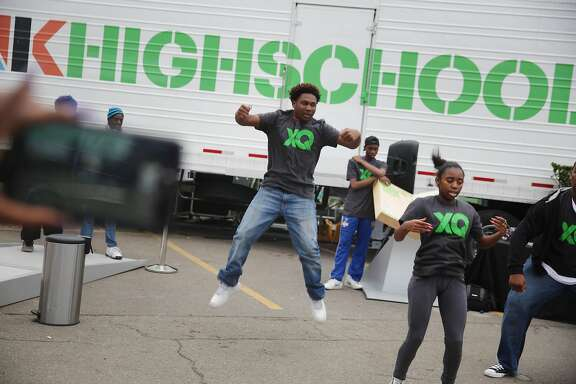 Future Shock members, a youth dance group with Culture Shock Oakland,  Jalen Hodge, 14, Envision High School; Chevelle Robinson, 16, Mission High School and Romeikus Moore, 16, City Arts & Technology High School, perform at the XQ roadshow on Wednesday, December 9,  2015 in Oakland, Calif. Envision High School is one of  several Bay Area schools which partner with the a non-profit organization entitled Build that provides entrepreneurship-based learning to underserved high schoolers.