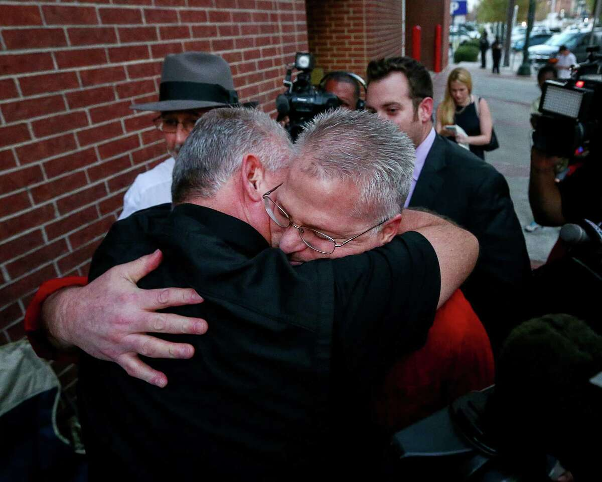 David Temple is greeted by family members as he leaves the Harris County Jail, after being released from prison, Wednesday, Dec. 28, 2016, in Houston. In 2007, Temple was convicted of killing his wife and sentenced to life in prison. In November, a state appeals court overturned that conviction, finding Harris County prosecutors deliberately withheld evidence and deprived him of a fair trial.