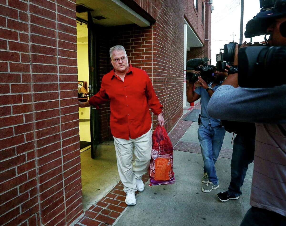 David Temple is greeted by news cameramen as he leaves the Harris County Jail, after being released from prison, Wednesday, Dec. 28, 2016, in Houston. In 2007, Temple was convicted of killing his wife and sentenced to life in prison. In November, a state appeals court overturned that conviction, finding Harris County prosecutors deliberately withheld evidence and deprived him of a fair trial.