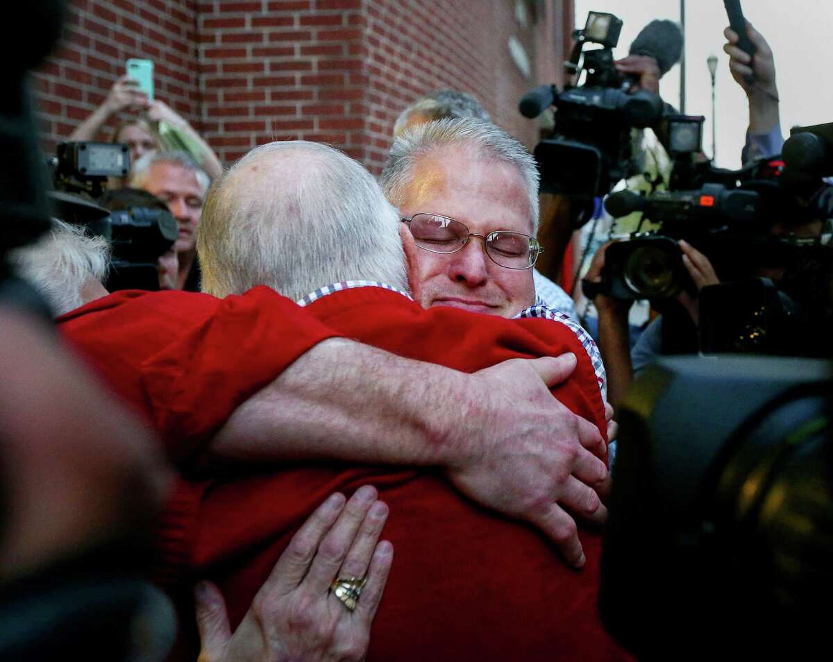 Temple's father, Kenneth, greets his son outside the Harris County Jail on Wednesday.