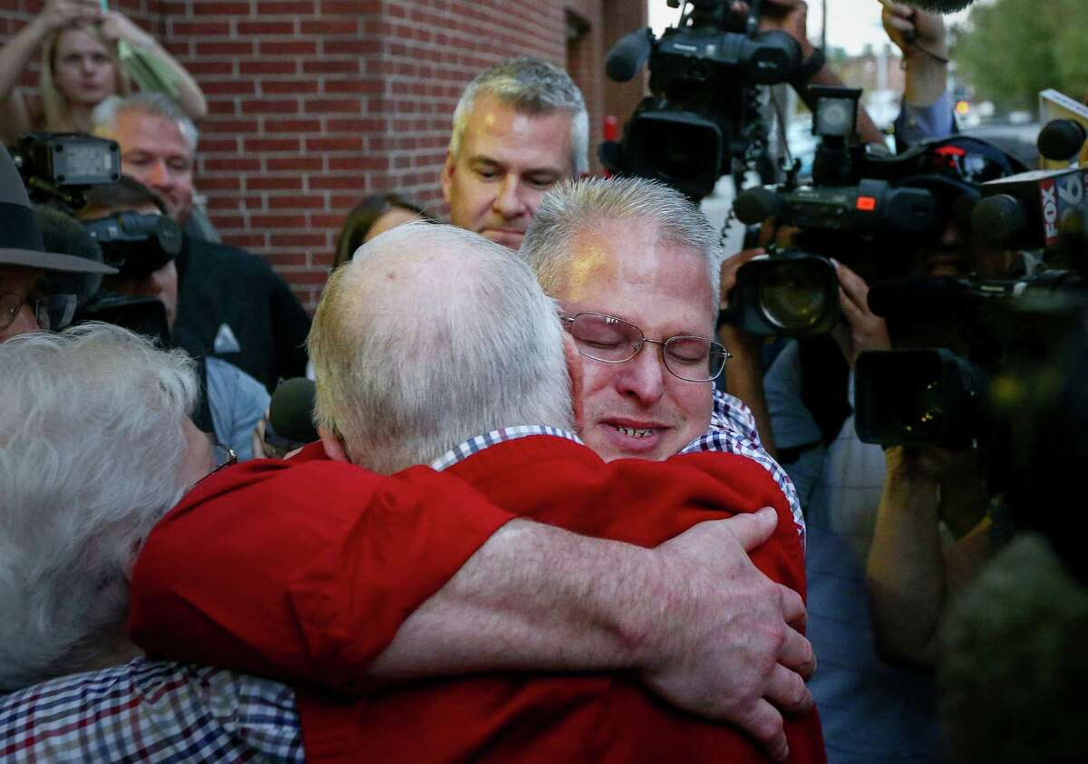 David Temple, center, is greeted by family members as he leaves the Harris County Jail, after being released from prison, Wednesday, Dec. 28, 2016, in Houston. In 2007, Temple was convicted of killing his wife and sentenced to life in prison. In November, a state appeals court overturned that conviction, finding Harris County prosecutors deliberately withheld evidence and deprived him of a fair trial.
