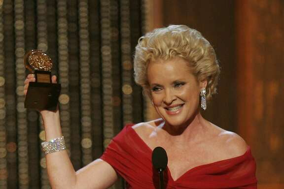 "Christine Ebersole accepts her award for Best Performance by a Leading Actress in a Musical for her work on ""Grey Gardens"" at the 61st Annual Tony Awards in New York, Sunday, June 10, 2007. (AP Photo/Jeff Christensen)"