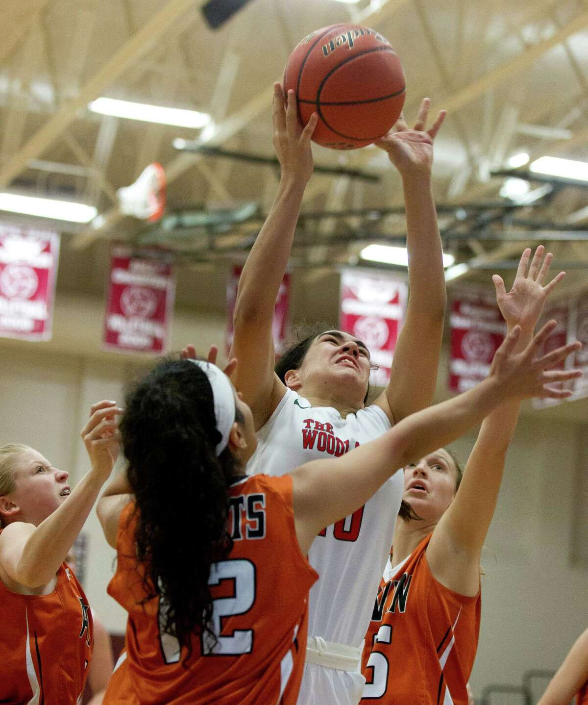 The Woodlands forward Luisa De La Rosa (10) grabs a rebound over Alvin guard Dalila Duran during the third quarter of a high school girls basketball game at the Magnolia Holiday Hoop Fest Wednesday, Dec. 28, 2016, in Magnolia. The Woodlands defeated Alvin 43-28.