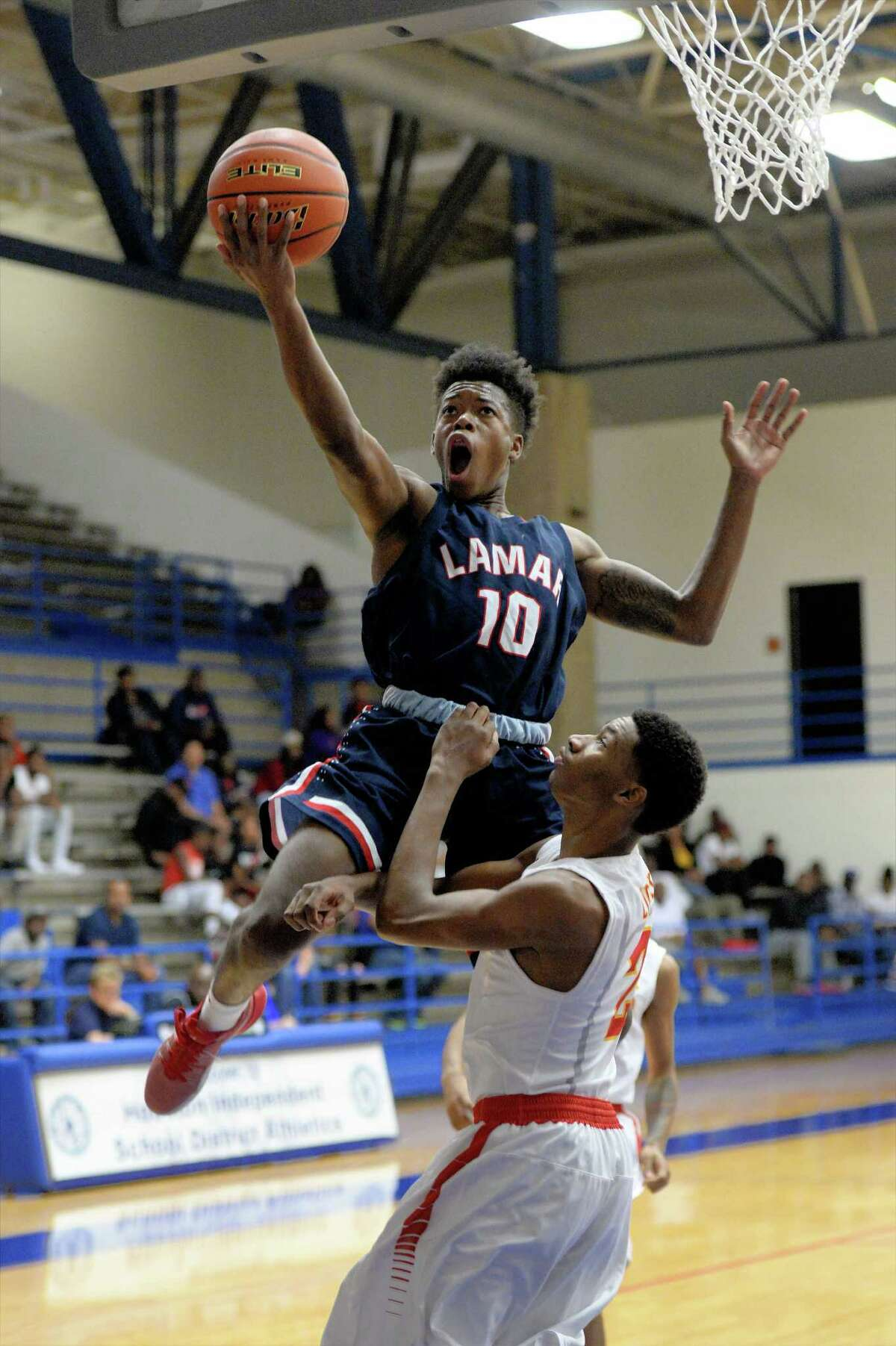 David Shepard (10) of Lamar drives to the hoop during the first half of a boys basketball game between the Lamar Texans and the Yates Lions at the Houston ISD Tournament on Saturday December 17, 2016 at The Pavilion, Houston, TX.