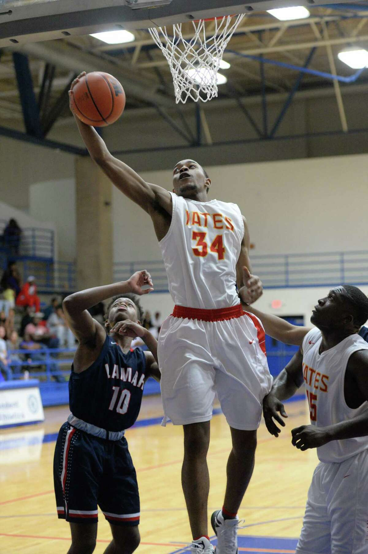 Darius Arvie (34) grabs a rebound during the second half of a boys basketball game between the Lamar Texans and the Yates Lions at the Houston ISD Tournament on Saturday December 17, 2016 at The Pavilion, Houston, TX.