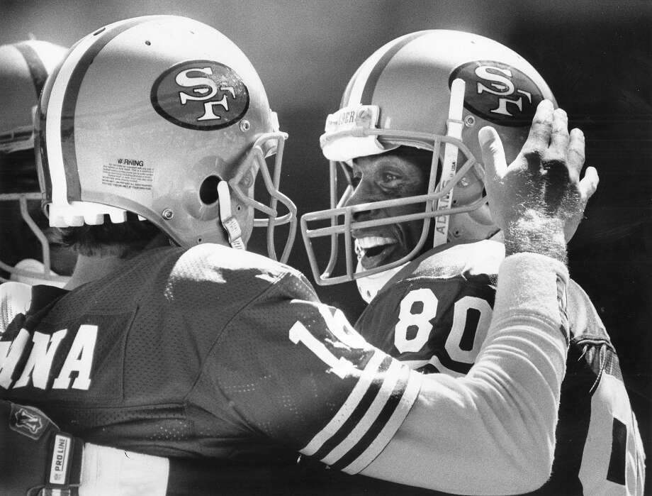 Joe Montana and Jerry Rice after connecting for a TD against Washington on Sept. 16, 1990. Photo: Deanne Fitzmaurice, The Chronicle 1990