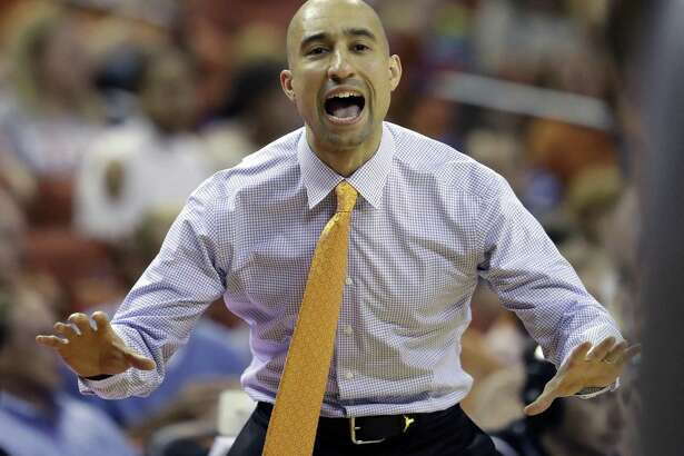 Shaka Smart said his team lacked 's basketball team Texas coach Shaka Smart calls to his players during the first half on an NCAA college basketball game against Kent State, Tuesday, Dec. 27, 2016, in Austin, Texas. (AP Photo/Eric Gay)