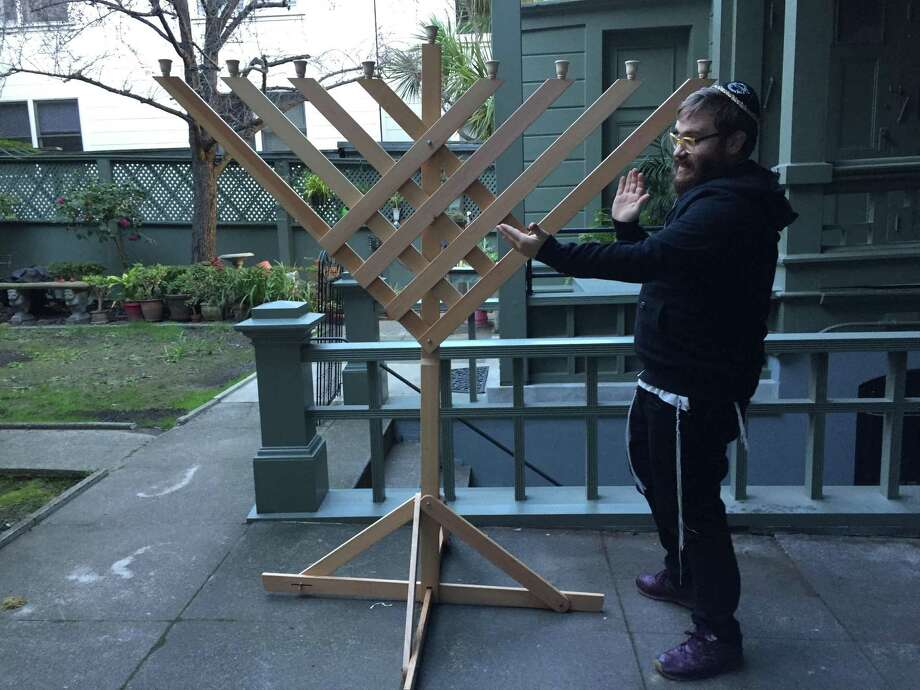Rabbi Peretz Mochkin received a fold-up menorah in the mail Wednesday morning, replacing the steel one that was stolen from Washington Square Park in San Francisco.