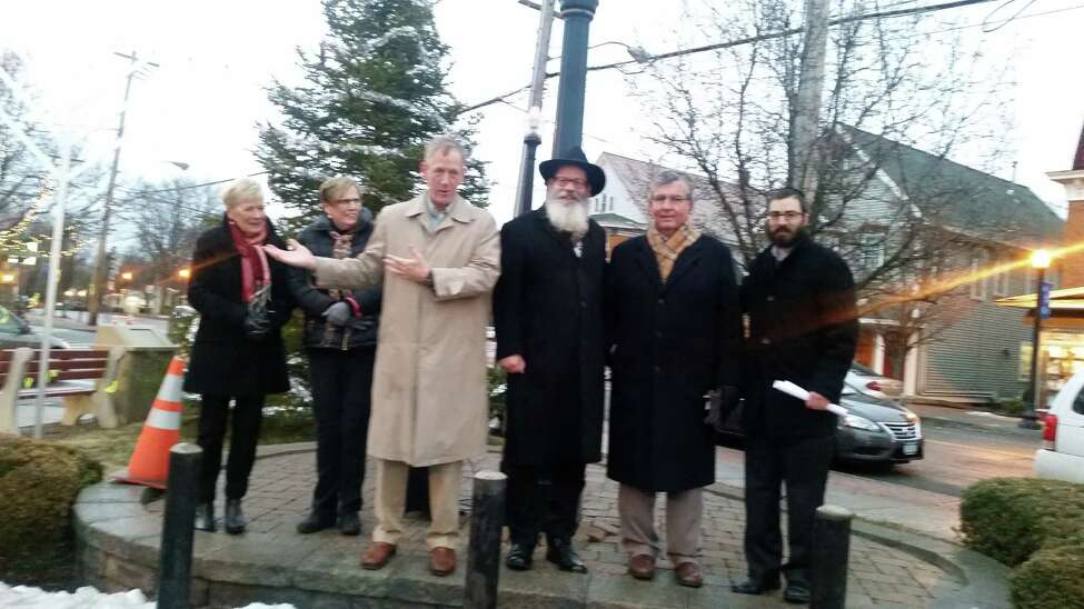 Local and religious leaders participate in a menorah lighting on Monday, Dec. 26, 2016, in Bethlehem, NY. From left are town councilwomen Doris Davis and Joyce Becker, Supervisor John Clarkson, Rabbi Nachman Simon from the Chabad House of Delmar, state Sen. Neil Breslin and Rabbi Zalman Simon from the Bethlehem Chabad House. (Photo submitted by the Bethlehem Chabad)