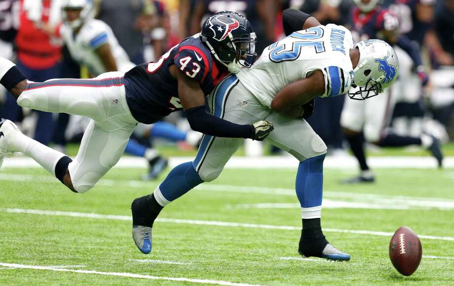 Texans free safety Corey Moore breaks up a pass intended for Lions running back Theo Riddick. Moore has started the past four games, making 20 tackles and defending three passes with no interceptions. Photo: Brett Coomer, Staff / © 2016 Houston Chronicle