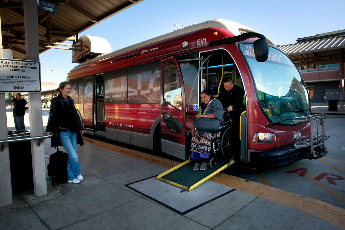 Passengers board an all electric Proterra bus pulls into a 10 minute charging station at the Regional Transit Station in downtown Stockton, California, on Wednesday December 28, 2016. The Stockton-based San Joaquin Regional Transit District currently operates two 35-foot Proterra buses in their fleet.