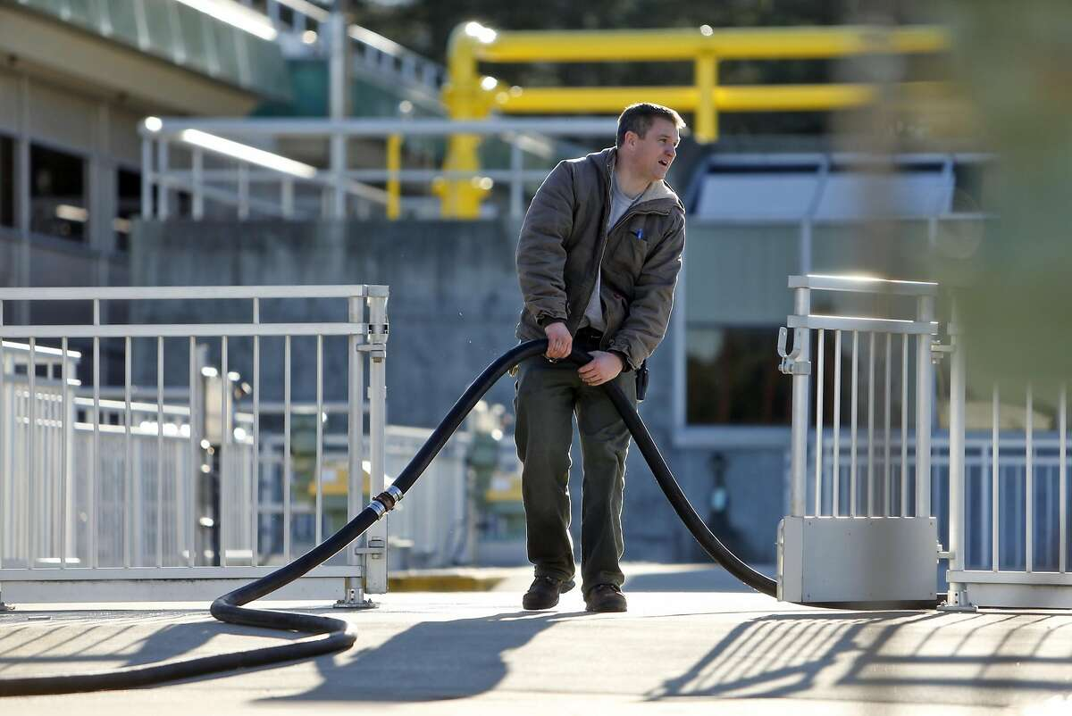 Tim Kennedy fills a flocculation basin last week at the Harry Tracy Water Treatment Plant in San Bruno.