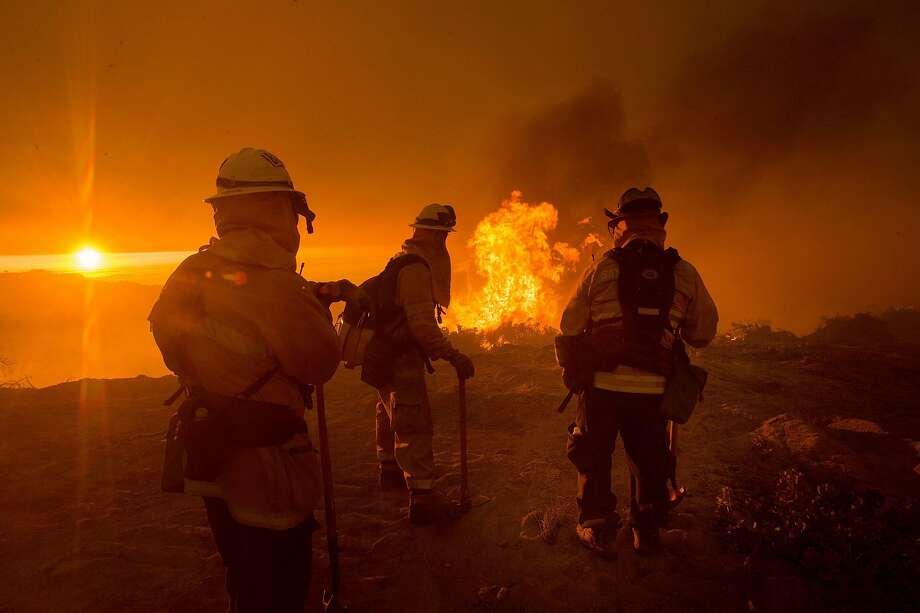 Firefighters battle the Soberanes Fire as it jumps a containment line in Carmel Highlands in Monterey County in 2016. An abandoned, illegal campfire started the fire. Photo: Noah Berger / Special To The Chronicle 2016