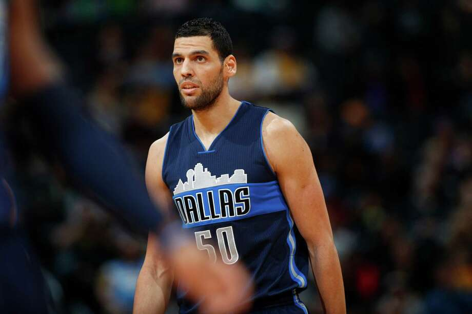"""Basketball fans were quick to call out Dallas Mavericks' Salah Mejri, who """"tripped"""" Spur Patty Mills as he walked off the court, but the NBA will not. Photo: David Zalubowski, Associated Press / AP"""