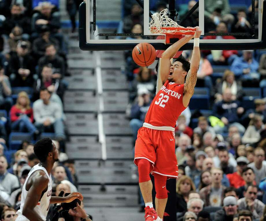 Houston's Rob Gray reacts while dunking the ball as Connecticut's Kentan Facey, left, looks on, in the first half of an NCAA college basketball game, Wednesday, Dec. 28, 2016, in Hartford, Conn. (AP Photo/Jessica Hill) Photo: Jessica Hill, FRE / AP2016