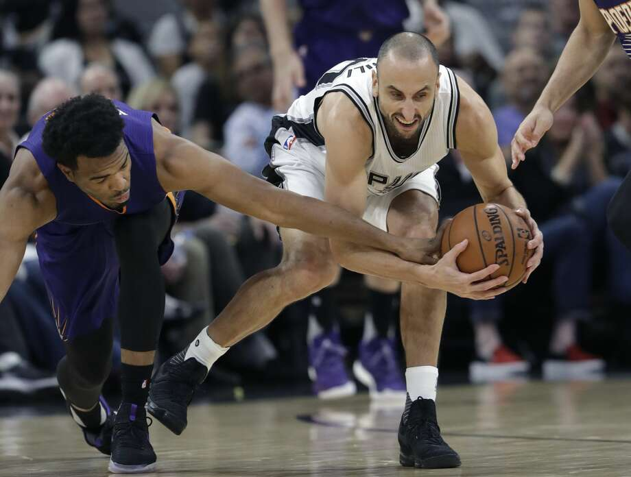 Phoenix Suns forward T.J. Warren, left, and San Antonio Spurs guard Manu Ginobili (20) scramble for a loose ball during the first half of an NBA basketball game, Wednesday, Dec. 28, 2016, in San Antonio. (AP Photo/Eric Gay) Photo: Eric Gay/Associated Press