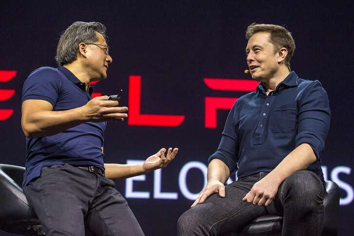 Jen-Hsun Huang, chief executive officer of Nvidia Corp., left, speaks with Elon Musk, co-founder and chief executive officer of Tesla Motors Inc., during the GPU Technology Conference (GTC) in San Jose, California, U.S., on Tuesday, March 17, 2015. Musk said that we�ll �take autonomous cars for granted� in a short period of time and signaled that the automaker plans to be a leader in the nascent market. Photographer: David Paul Morris/Bloomberg *** Local Caption *** Jen-Hsun Huang; Elon Musk