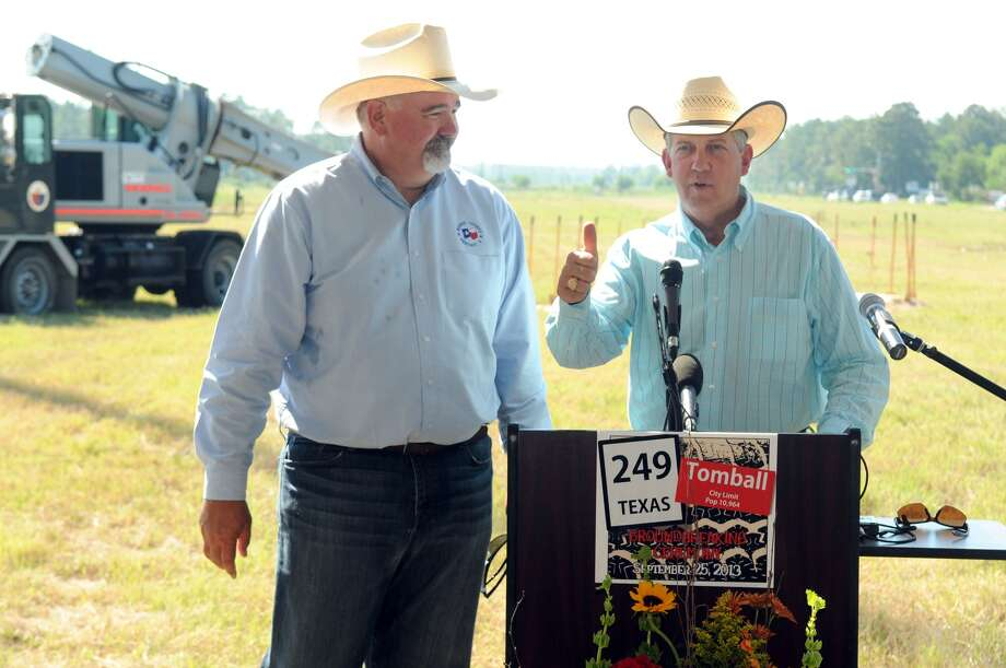 Harris County Precinct 4 Commissioner R. Jack Cagle, left, and then Montgomery County Precinct 2 Commissiner Craig Doyal share the podium during the Highway 249 Extension Tomball Tollway Groundbreaking ceremony in 2014. Photo: Jerry Baker, Freelance