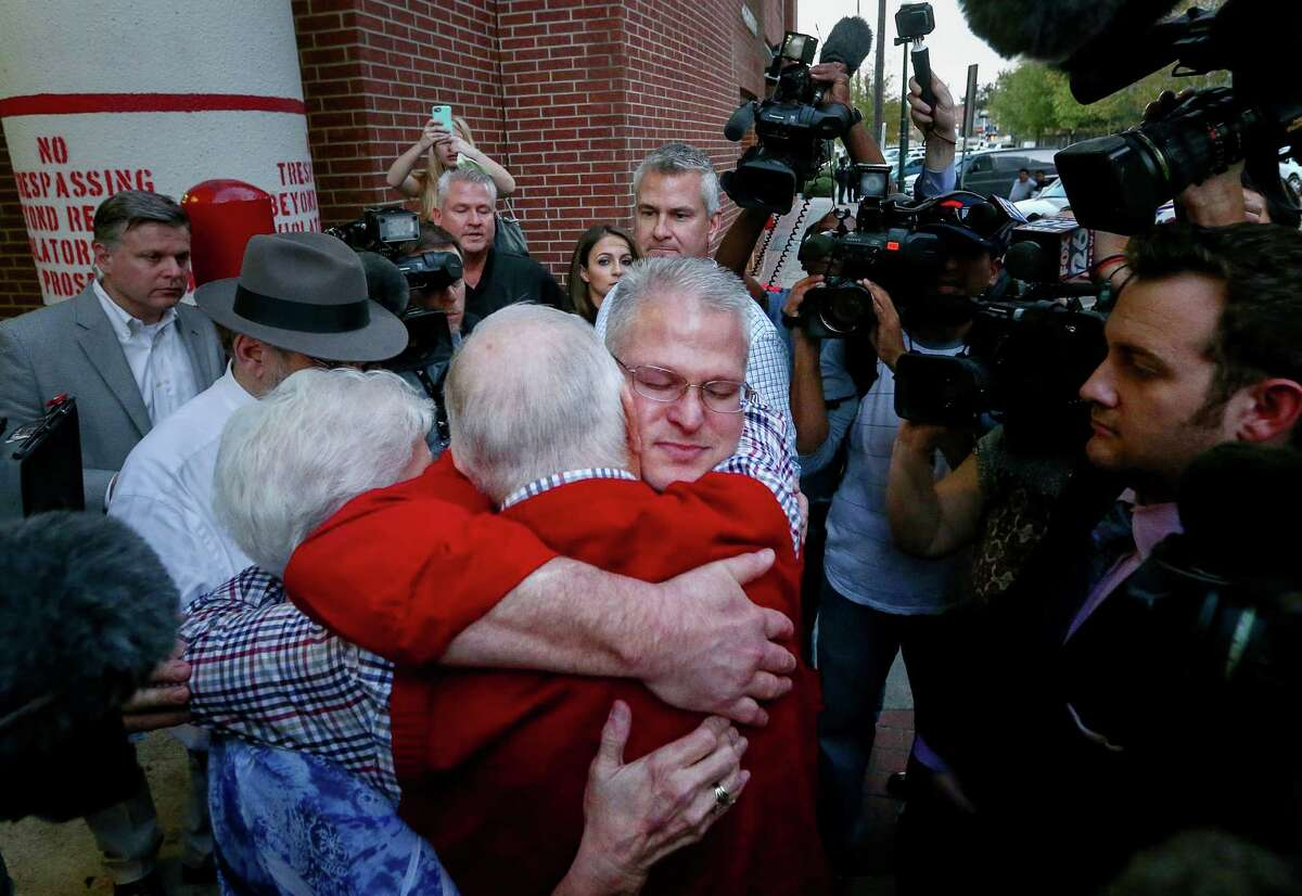 David Temple is greeted by his parents, Kenneth and Maureen, as he leaves the Harris County jail.
