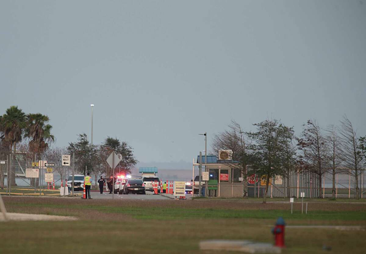 Emergency responders at the scene of the Apache helicopter crash in Galveston Bay on Wednesday.