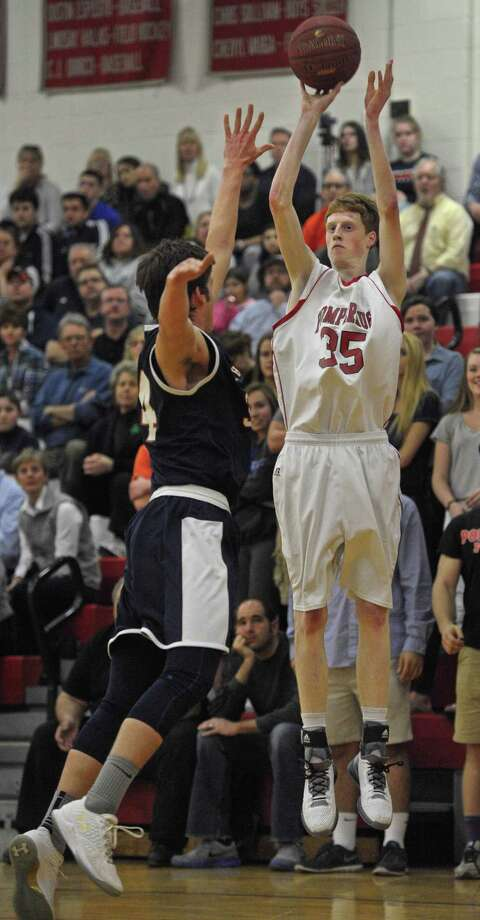 FILE PHOTO: Pomperaug's Josh McGettigan (35) shoots over Lyman Hall's Kyle Shea (34) in the boys Class L second-round basketball game between Lyman Hall and Pomperaug high schools, on Wednesday night, March 9, 2016, at Pomperaug High School, Southbury, Conn. Photo: H John Voorhees III H. John Voorhees III / Hearst Connecticut Media / The News-Times