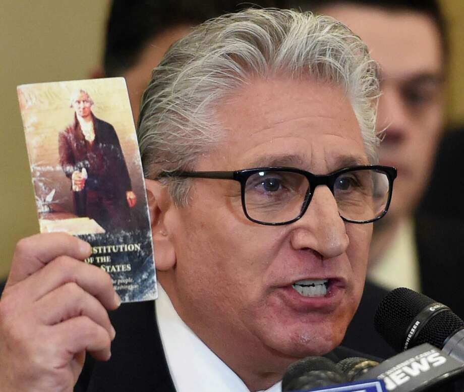 Assemblyman Jim Tedisco holds a copy of the United State Constitution while making his announcement as a Republican candidate for the 49th Senate District on Thursday, May 12, 2016, in Clifton Park, N.Y. (Skip Dickstein/Times Union archive) Photo: SKIP DICKSTEIN / 20036577A