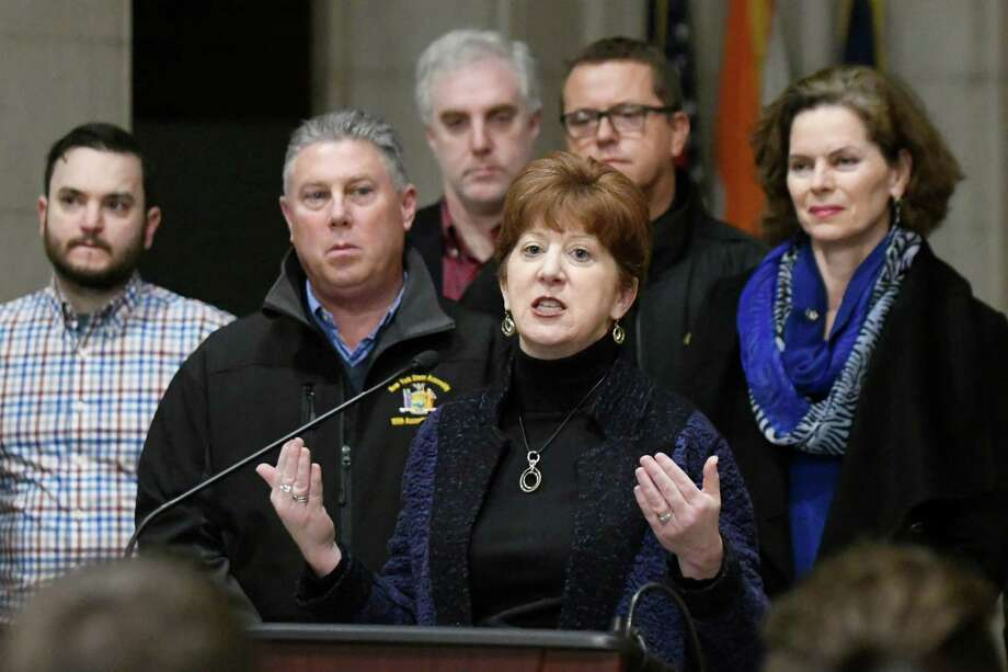 Mayor Kathy Sheehan, center, calls on legislators to approve ridesharing in the 2017 session during the Capital Region Ridesharing Coalition's news conference on Wednesday, Dec. 28, 2016, at City Hall in Albany, N.Y. (Cindy Schultz / Times Union) Photo: Cindy Schultz / Albany Times Union