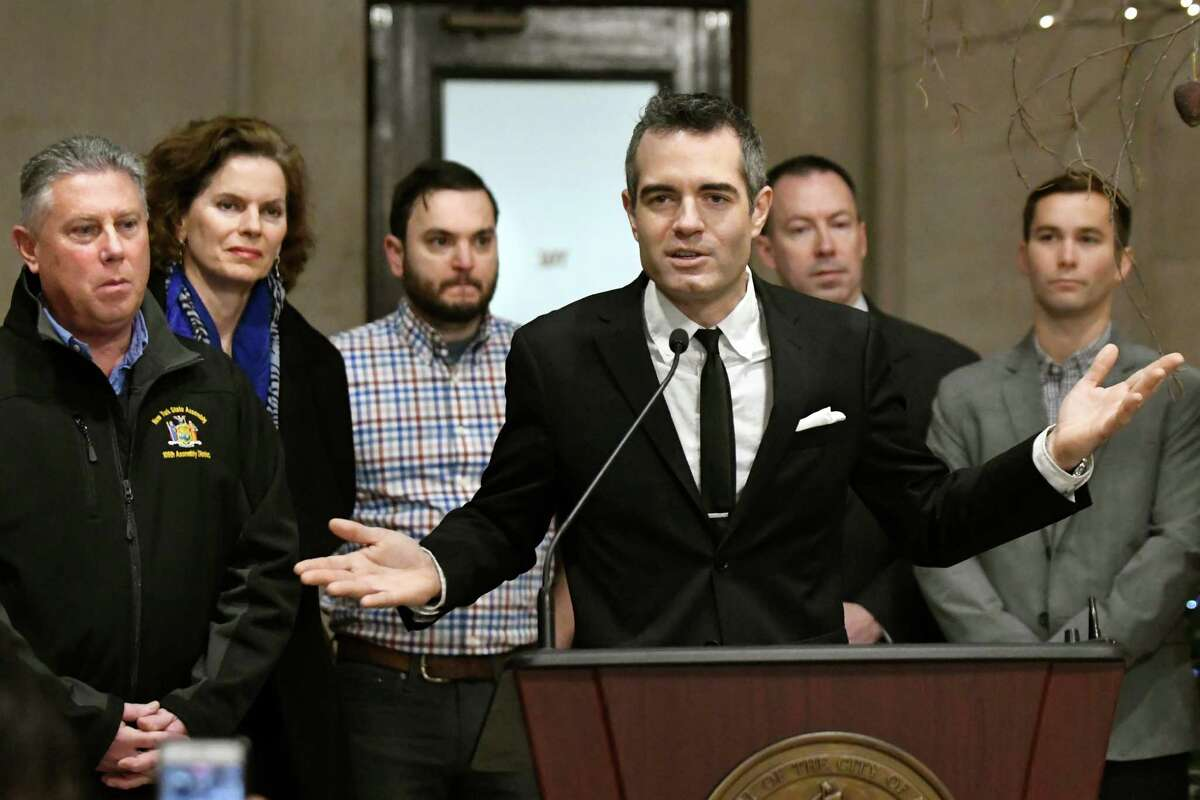 Business owner Vic Christopher, center, calls on legislators to approve ridesharing in the 2017 session during the Capital Region Ridesharing Coalition's news conference on Wednesday, Dec. 28, 2016, at City Hall in Albany, N.Y. (Cindy Schultz / Times Union)