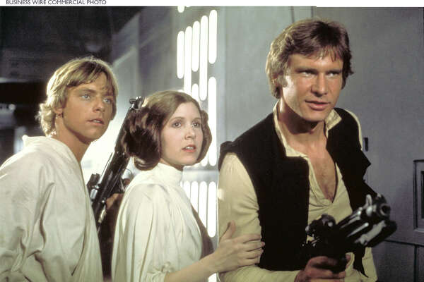 Mark Hamill, Carrie Fisher and Harrison Ford attempt to escape Darth Vader. Some Twitter users found a tweet by Cinnabon after Fisher's death tasteless. The company apologized, and a Twitter debate ensued.