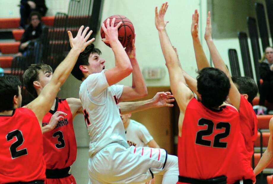 Shelton's Brian Berritto lays up the ball as several New Canaan players defend during boys basketball action in Shelton, Conn., on Wednesday Dec. 28, 2016. Photo: Christian Abraham / Hearst Connecticut Media / Connecticut Post