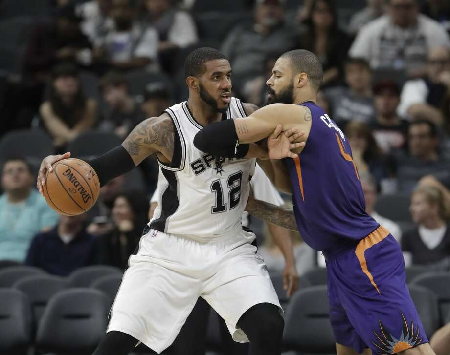 San Antonio Spurs forward LaMarcus Aldridge (12) is defended by Phoenix Suns center Tyson Chandler (4) during the second half of an NBA basketball game, Wednesday, Dec. 28, 2016, in San Antonio. San Antonio Spurs won 119-98. (AP Photo/Eric Gay) Photo: Eric Gay/Associated Press