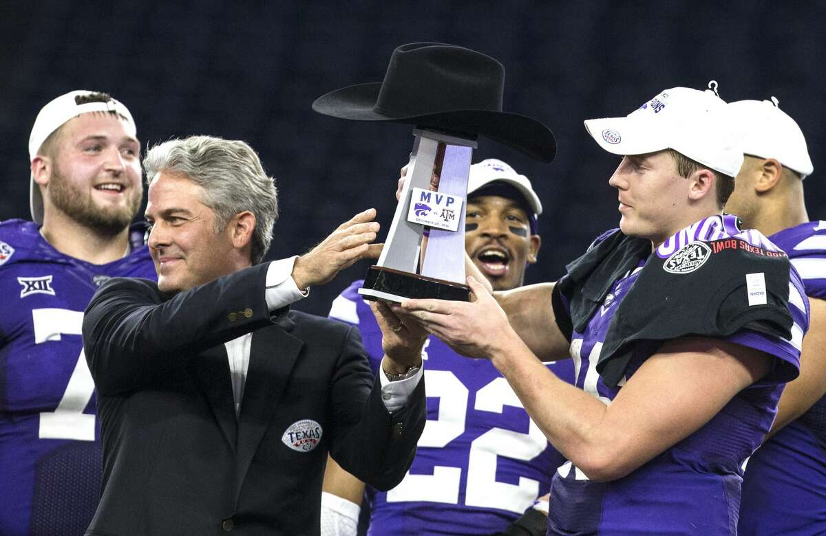 Kansas State quarterback Jesse Ertz (16) is handed the Most Valuable Player trophy after a 33-28 win over Texas A&M in the Advocare V100 Texas Bowl at NRG Stadium on Wednesday, Dec. 28, 2016, in Houston. ( Brett Coomer / Houston Chronicle )