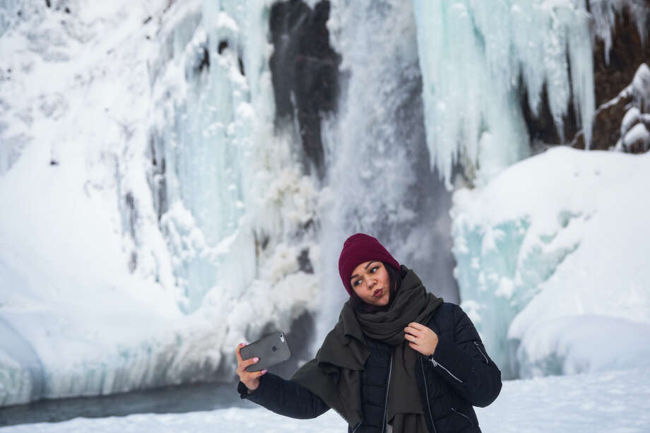 Tatsiana Yaromich takes a selfie at a frozen Franklin Falls near Snoqualmie Pass on Wednesday, Dec. 28, 2016. Photo: GRANT HINDSLEY, SEATTLEPI.COM / SEATTLEPI.COM