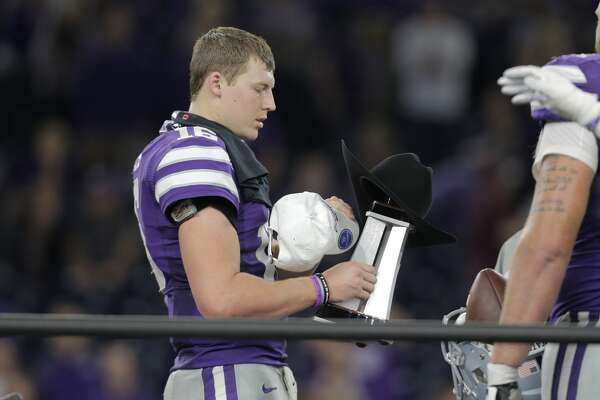 Kansas State quarterback Jesse Ertz (16) holds the MVP trophy after beatin gTexas A&M  33-28 during the Advocare V100 Texas Bowl at NRG Stadium on  Wednesday, Dec. 28, 2016, in Houston. ( Elizabeth Conley / Houston Chronicle )