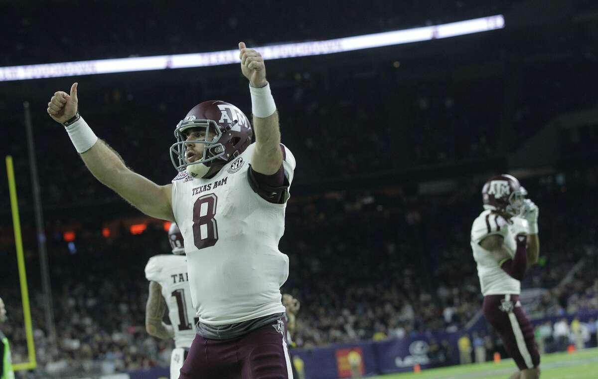 Texas A&M quarterback Trevor Knight (8) celebrates a touchdown that brought the Aggies within 5 points during the second half of the Advocare V100 Texas Bowl at NRG Stadium on Wednesday, Dec. 28, 2016, in Houston. Kansas City won the game 33-28. ( Elizabeth Conley / Houston Chronicle )
