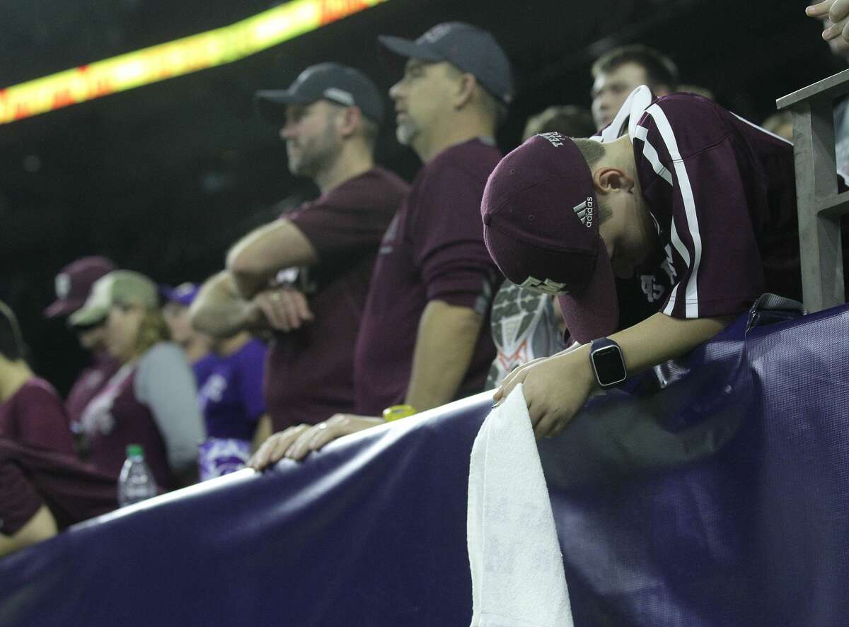 A Texas A&M fan reacts to the final seconds of game time during the second half of the Advocare V100 Texas Bowl at NRG Stadium on Wednesday, Dec. 28, 2016, in Houston. Kansas City won the game 33-28. ( Elizabeth Conley / Houston Chronicle )