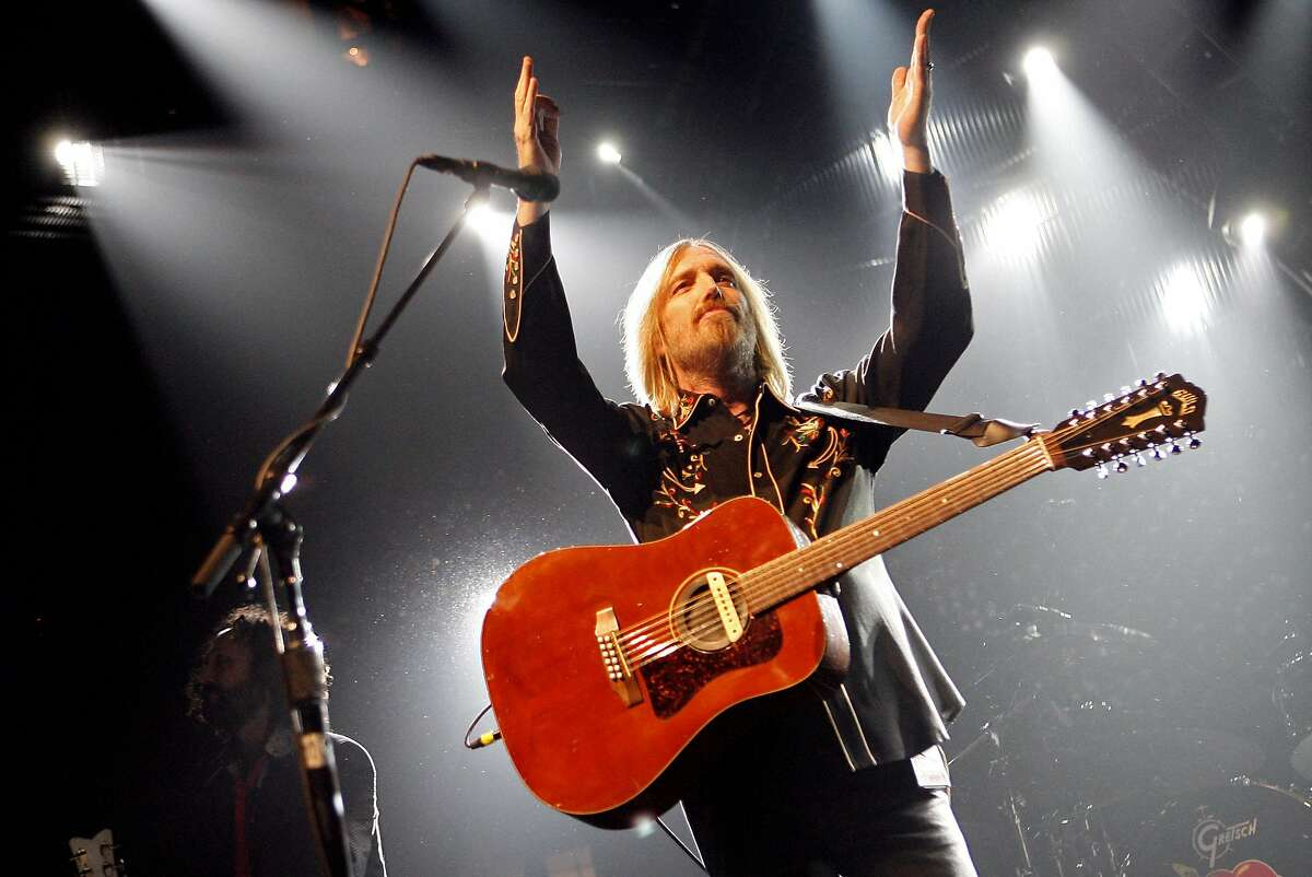 Tom Petty performs with The Heartbreakers during a stop on his summer tour at Madison Square Garden Tuesday, June 17, 2008 in New York. (AP Photo/Jason DeCrow)