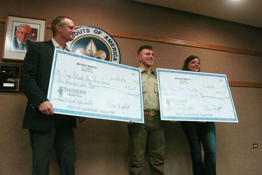 Harris McGrade, 17, donated $4,000 to Camp Urland, in Woodville, and $3,635 to the Bryan Hebert Memorial Foundation on Wednesday. The donations came from excess money raised for his Boy Scout Eagle project to renovate the Beaumont Police Department's obstacle training course. Photo: Sara E. Flores/The Enterprise