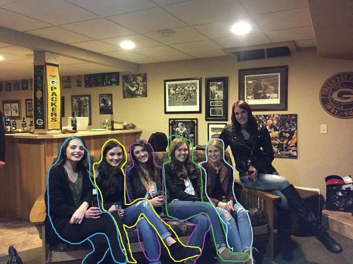A photo of five girls on a couch is stumping the internet this week because there appears to be a girl missing her legs in the photo. Source: Reddit