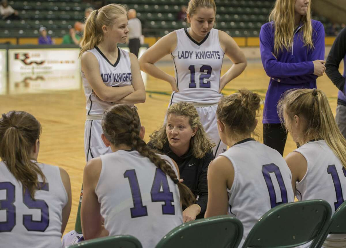 Midland Classical coach Carla Cunneen talks with her players Thursday 12-29-16 during a timeout in a matchup against Lee in the Byron Johnston Holiday Classic. Tim Fischer/Reporter-Telegram
