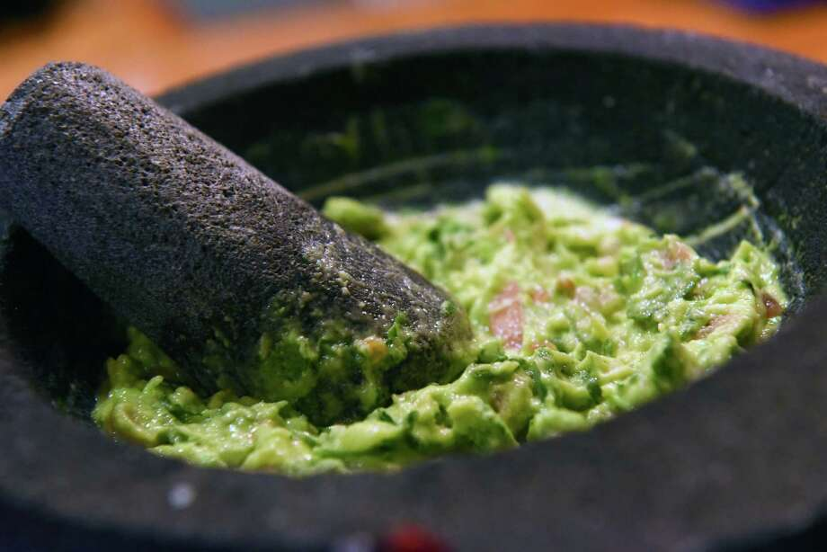 Fresh made table side guacumole at El Mariachi Tapas on Wednesday Dec. 21, 2016 in Albany, N.Y. (Michael P. Farrell/Times Union) Photo: Michael P. Farrell / 20039211A