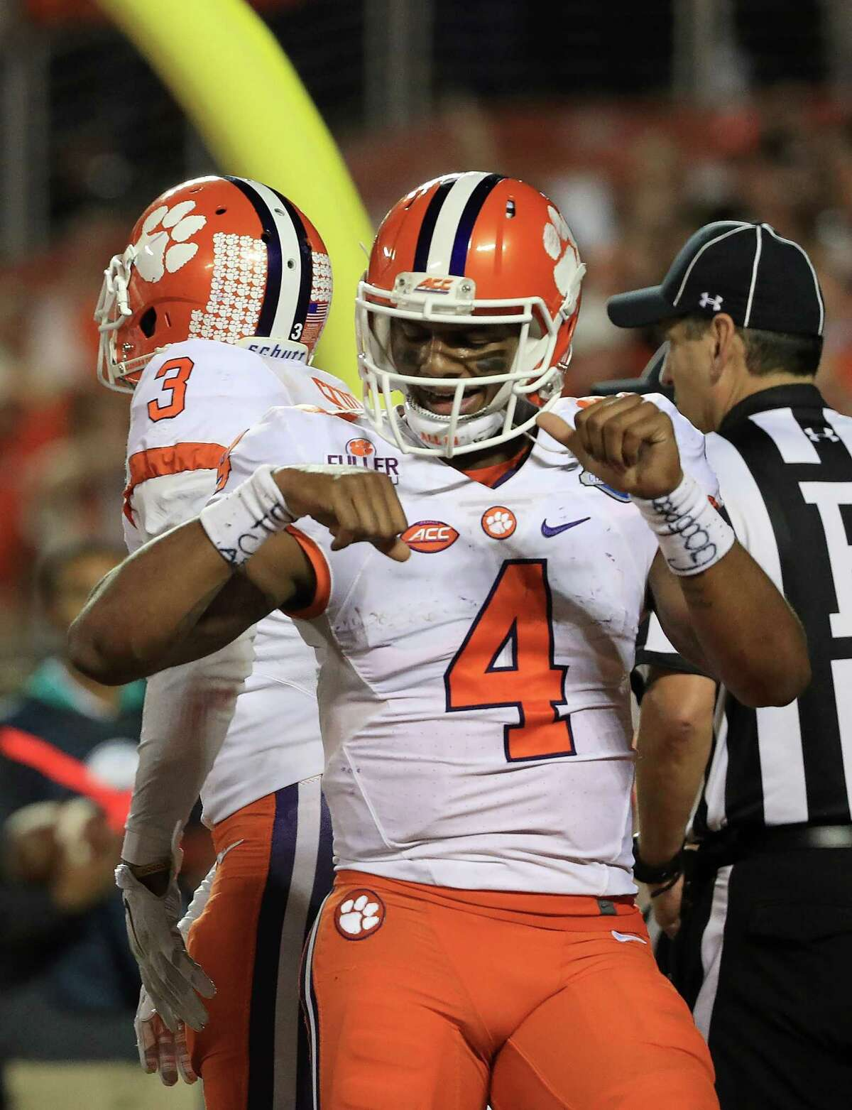 ORLANDO, FL - DECEMBER 03: Deshaun Watson #4 of the Clemson Tigers celebrates a touchdown the ACC Championship against the Virginia Tech Hokies on December 3, 2016 in Orlando, Florida. (Photo by Mike Ehrmann/Getty Images)