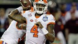 Quarterback Deshaun Watson led Clemson to its first championship in 30 years with three touchdown passes and one rushing score against Alabama on Jan. 9.