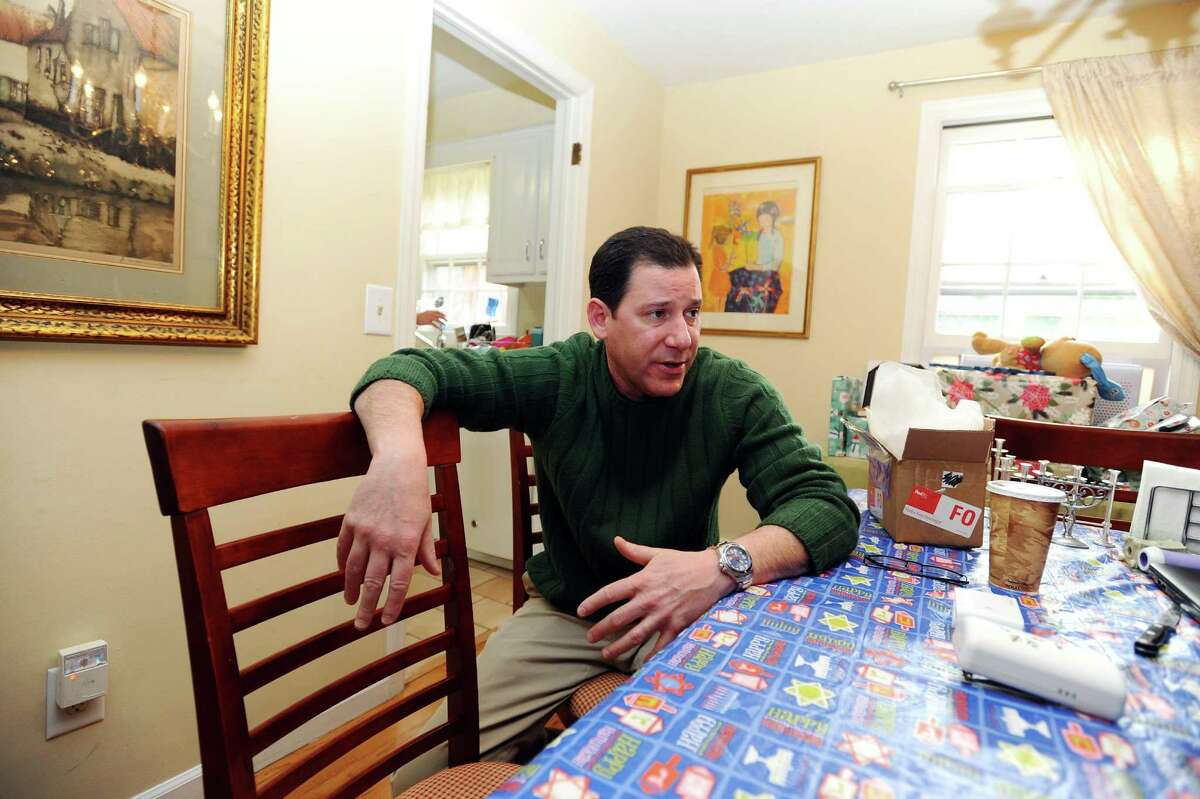 Marc Toland, founder and CEO of Safer Alarms Inc., discusses his various prototype alarms inside his home in Stamford, Conn. on Wednesday, Dec. 28, 2016.