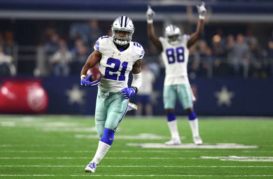 ARLINGTON, TX - DECEMBER 26: Ezekiel Elliott #21 of the Dallas Cowboys runs for a touchdown as teammate Dez Bryant #88 celebrates as the Cowboys play the Detroit Lions during the first half at AT&T Stadium on December 26, 2016 in Arlington, Texas. (Photo by Tom Pennington/Getty Images) Photo: Tom Pennington, Staff / 2016 Getty Images