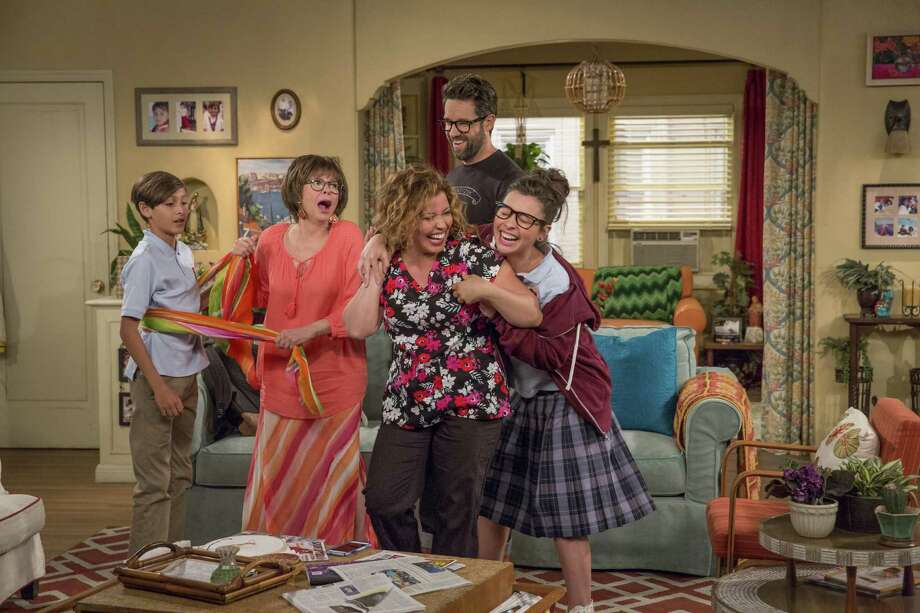 Rita Moreno, Justina Machado and the rest of the cast of 'One Day at a Time' enjoy a playful moment on Norman Lear's new Latino version of his classic TV hit. Photo: Michael Yarish / Netflix / Netflix