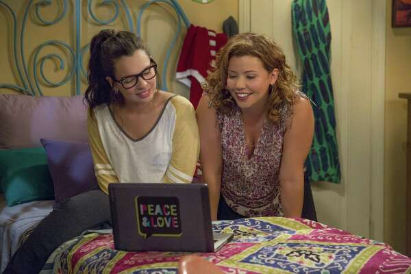 Mother and daughter (Justina Machado, right, and Isabella Gomez) embrace their differences and find a way to bond in 'One Day at a Time' on Netflix.